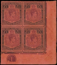 Leeward Islands 1938-51purple and black on carmine  £1, lower right corner marginal plate no. block of four with broken lower right scroll SG 114ae